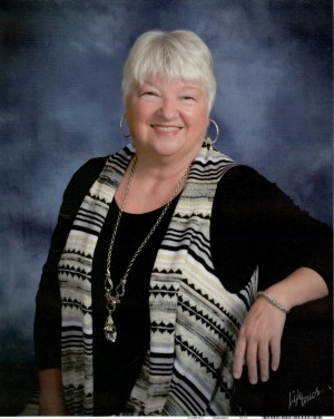 Photo of Dorothy Fletcher wearing black shirt and stripped vest